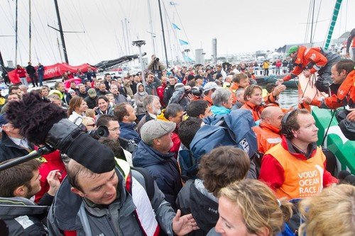 Groupama Sailing Team, skippered by Franck Cammas from France are greeted by family, fans and the media on the dock, after taking first place on leg 8 © Ian Roman/Volvo Ocean Race http://www.volvooceanrace.com