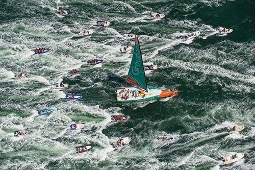 Groupama Sailing Team, skippered by Franck Cammas from France, are followed in by a huge fleet of spectator boats, after claiming victory in the Bretagne In-Port Race,in Lorient, France,during the Volvo Ocean Race 2011-12. © Paul Todd/Outside Images http://www.outsideimages.com