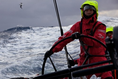 Thomas Johanson drives in the Southern Ocean swell with a passing an albatross in the distance. Puma Ocean Racing during leg 5 of the Volvo Ocean Race 2011-12, from Auckland, New Zealand, to Itajai, Brazil.  © Amory Ross/Puma Ocean Racing/Volvo Ocean Race http://www.puma.com/sailing