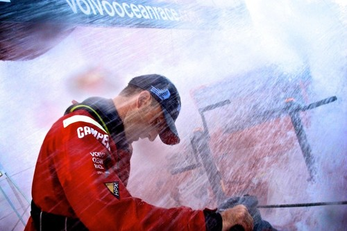 Andrew McLean bears the brunt of the force of the water on the aft grinding pedestal, onboard Camper during leg 7 of the Volvo Ocean Race 2011-12, from Miami, USA to Lisbon, Portugal.  © Hamish Hooper/Camper ETNZ/Volvo Ocean Race