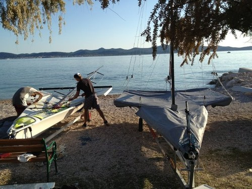 2 x NZL boats in Zadar. Marcus and Josh putting their mast back up after measurement © Peter Burling and Blair Tuke