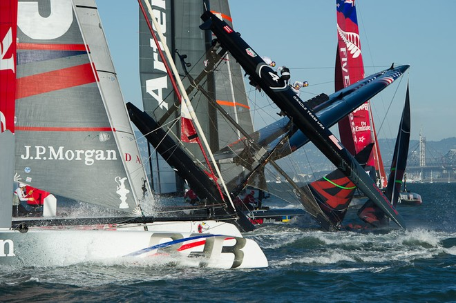 Oracle Team USA digs the bows in and capsizes at the first mark in the first fleet race of day four of the America's Cup World Series, San Francisco  ©  SW