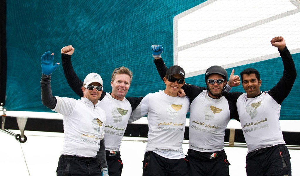 Oman Air celebrating after winning the act today, skippered by Morgan Larson (USA), with tactician Will Howden (GBR), mainsail trimmer Charlie Ogletree (USA), headsail trimmer Andy Maloney (NZL) and bowman Nasser Al Mashari (OMA). © Lloyd Images http://lloydimagesgallery.photoshelter.com/