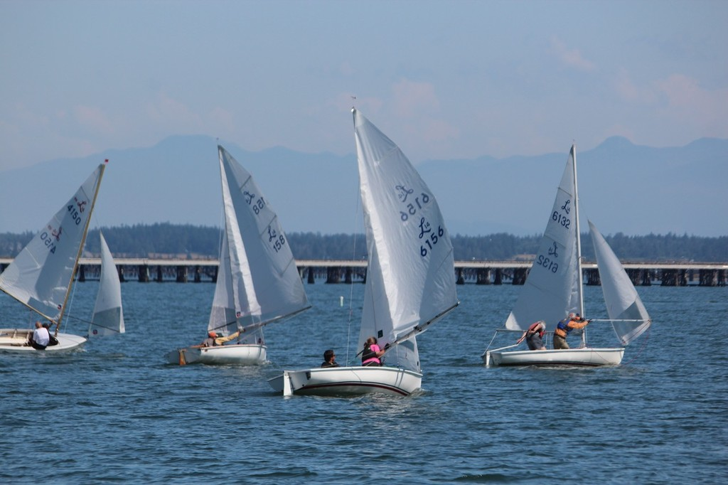 Downwind leg with Cascade Mountain  range in background - 2012 Lido 14 National Championships © Tony Billera