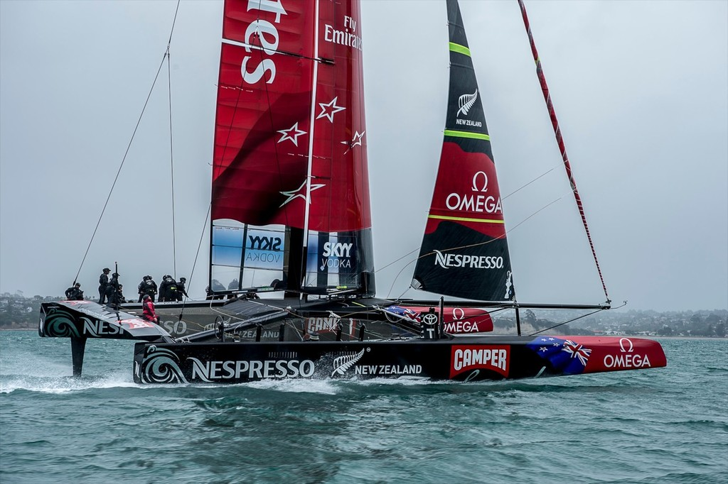 Sail-World's Richard Gladwell (red wet weather gear) , checks out the wingsail twist as Emirates Team New Zealand's AC72 rips across the Hauraki Gulf at speeds of over 40kts © Chris Cameron/ETNZ http://www.chriscameron.co.nz