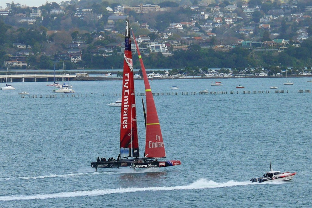 5 - AC72 - New Zealand fully lifted on her L-Foils and sailing on the Waitemata Harbour, Auckland, New Zealand. The windward L-foil is shown clear of the water in compliance with AC racing rules. photo copyright Swan Images http://www.sail-world.com taken at  and featuring the  class