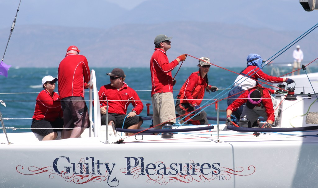 Guilty Pleasure coming across the finish line SeaLink Magnetic Island Race Week 2012 © Andrea Falvo SeaLink Magnetic Island Race Week 2012