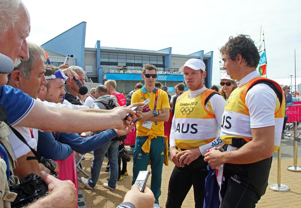 49er Gold medalists, Nathan Outteridge and Iain Jensen (right) milking the media zone, while their two minders (in sunglasses) from Yachting Australia positively purr in the background. © Richard Gladwell www.photosport.co.nz