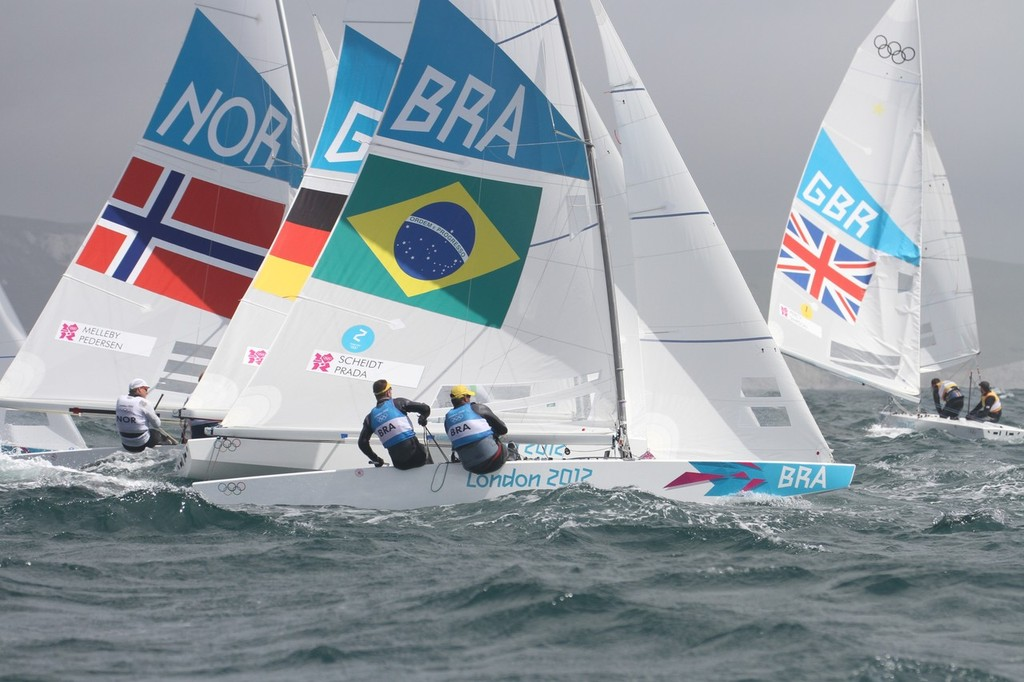 August 1, 2012 - Weymouth, England - Stars in big seas at top mark © Richard Gladwell www.photosport.co.nz