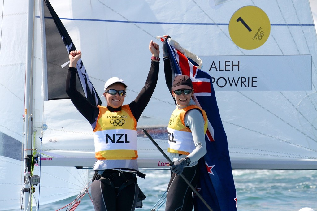 Olivia Powrie and Jo Aleh salute the Nothe crowd soon after winning the Gold Medal at Weymouth in August 2012. © Richard Gladwell www.photosport.co.nz