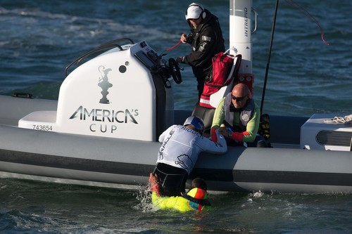 Crew are retrieved after Oracle Spithill pitchpoles at the first mark of the fleet racing on Day 4 of the America's Cup World Series © ACEA - Photo Gilles Martin-Raget http://photo.americascup.com/