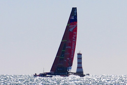 Emirates Team NZ clears Rangitoto Light at the start of yesterday's testing session in 15-20kts © Richard Gladwell www.photosport.co.nz