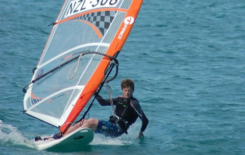 14 year old Murray's Bay sailor Patrick Haybittle hanging 5 on the way back in after training in Noumea © Brian Haybittle