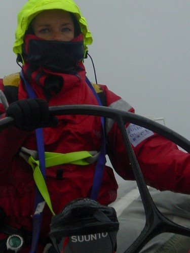 Bridget Suckling at the helm in heavy weather gear on Amer Sports Too © Volvo Ocean Race http://www.volvooceanrace.com