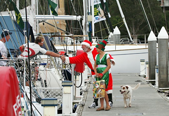 Santa stopped to greet all and sundry with the help of Elf, Alex, and a wonderfully enthusiastic pooch, as well. - Rolex Sydney Hobart Yacht Race ©  John Curnow