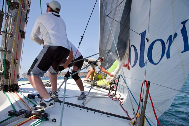 Matt Cubit and the gang hoist the spinnaker.  - Rolex Sydney Hobart Yacht Race ©  Alex McKinnon Photography http://www.alexmckinnonphotography.com
