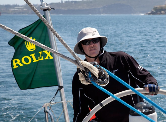 Bryan Bailie behind the helm of the VO60, Merit. - Rolex Sydney Hobart Yacht Race ©  Alex McKinnon Photography http://www.alexmckinnonphotography.com
