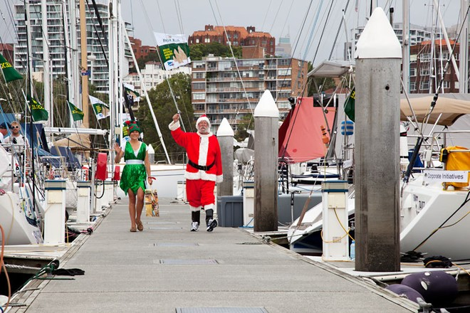 Santa and Elf come striding down the dock at the CYCA. - Rolex Sydney Hobart Yacht Race ©  Alex McKinnon Photography http://www.alexmckinnonphotography.com