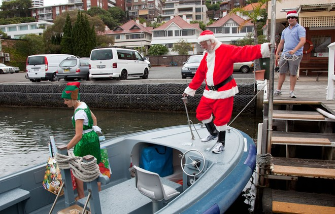 Santa boards for his short nautical journey that is part of his huge worldwide tour... - Rolex Sydney Hobart Yacht Race ©  Alex McKinnon Photography http://www.alexmckinnonphotography.com
