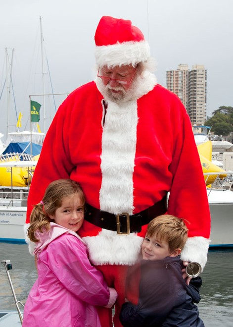 Santa was flocked to by all the kids and a few adults, too. - Rolex Sydney Hobart Yacht Race ©  Alex McKinnon Photography http://www.alexmckinnonphotography.com