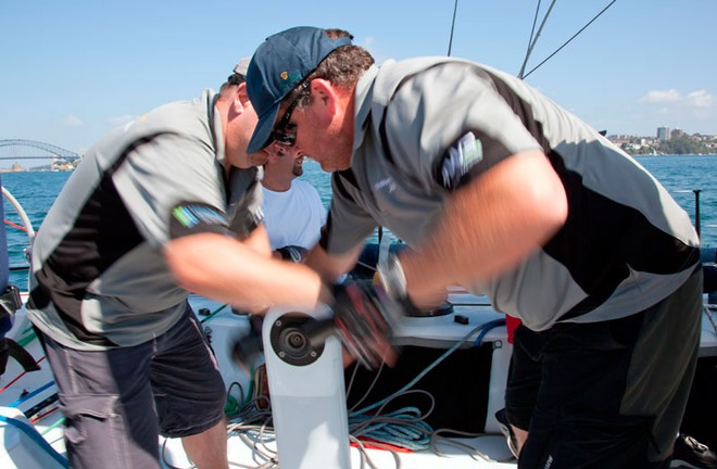 Grinding away on board the VO60, Merit. - Rolex Sydney Hobart Yacht Race ©  Alex McKinnon Photography http://www.alexmckinnonphotography.com