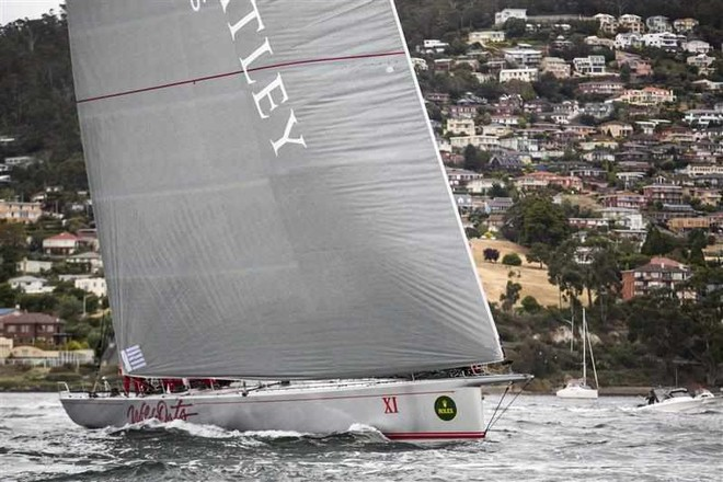 Wild Oats XI at the finish line in Hobart, setting a new race record of 1 day 18 hours 23 mins 12 secs © ROLEX-Carlo Borlenghi