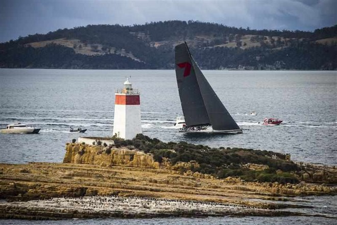 Wild Oats XI passes the Iron Pot Lighthouse at the entrance to the Derwent River on her way to a sixth line honours victory and new race record © ROLEX-Carlo Borlenghi