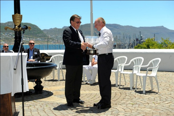 St Helena Governor, Mark Capes, receives the Governor's Cup from Billy Leisegang (Manager of False Bay Yacht Club) to take back to the Island ready to be presented to the winners of the race. © Polly Tyekiff http://www.governorscup.co.za