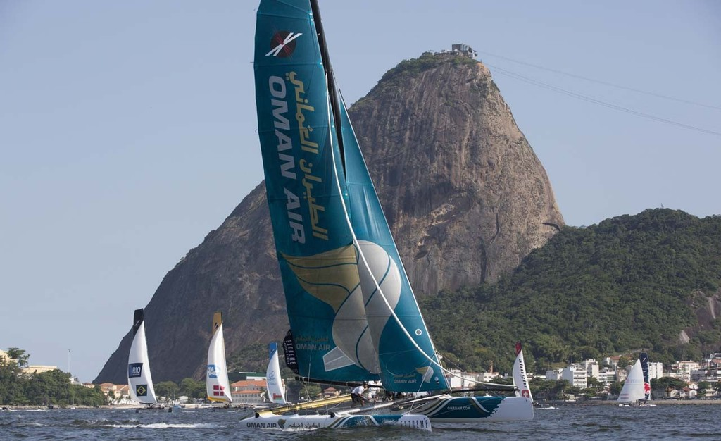 Oman Air leads the fleet downwind crossing in front of iconic Sugarloaf mountain in Rio - 2012 Extreme Sailing Series - Act 8 Rio © Lloyd Images http://lloydimagesgallery.photoshelter.com/