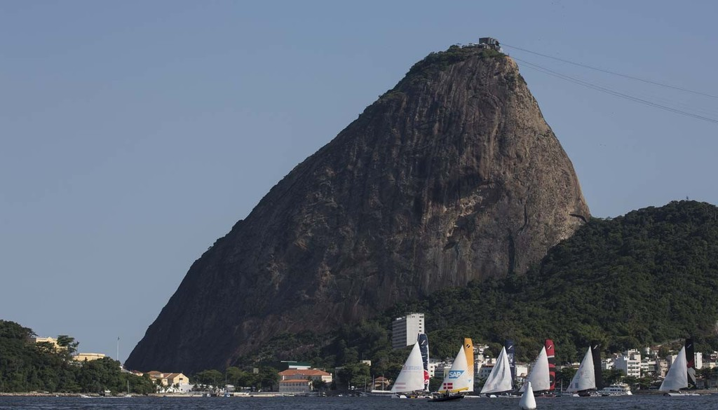 The fleet of Extreme 40s sails in front of iconic Sugarloaf mountain in Rio de Janeiro, Brazil - 2012 Extreme Sailing Series - Act 8 Rio © Lloyd Images http://lloydimagesgallery.photoshelter.com/