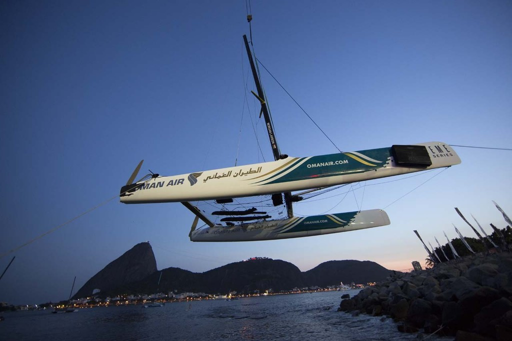 Oman Air is craned out for over-night repairs after a collision with Red Bull Sailing Team on day 1 in Rio - 2012 Extreme Sailing Series - Act 8 Rio © Lloyd Images http://lloydimagesgallery.photoshelter.com/