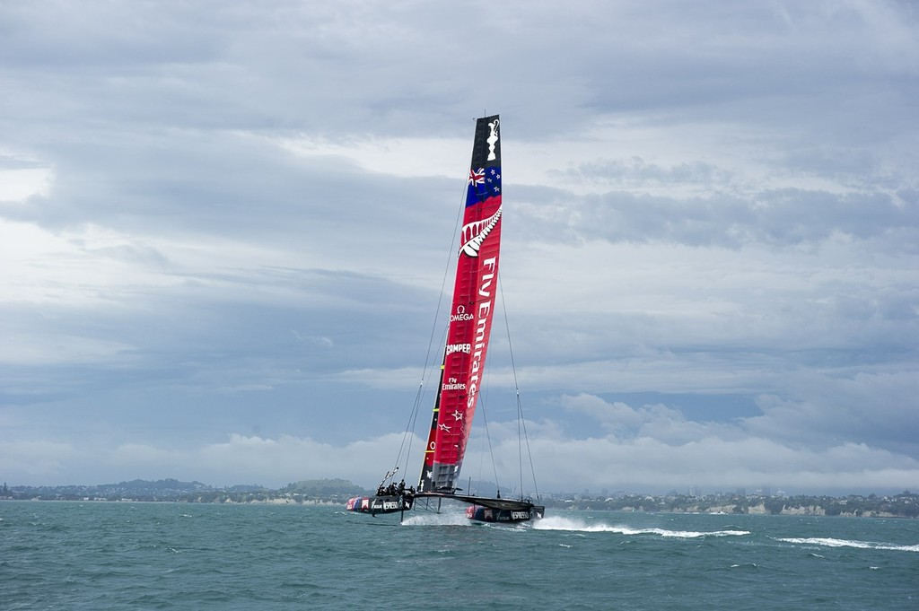 Emirates Team New Zealand training with  the team's first AC72 on the Hauraki Gulf, heading towards the Auckland storm. © Chris Cameron/ETNZ http://www.chriscameron.co.nz