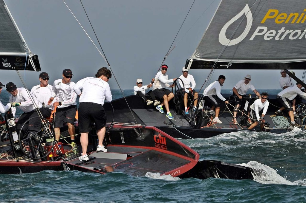 2013 RC44 Oman Cup - Ironbound's scoop is rip away from the hull after a collision with Team Aqua © RC44 Class/MartinezStudio.es