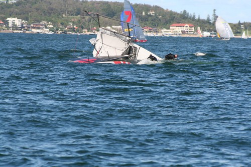 Yamaha seconds after nose diving, which sent the crew around the forestay, during Heat 2. © Lyn Holland