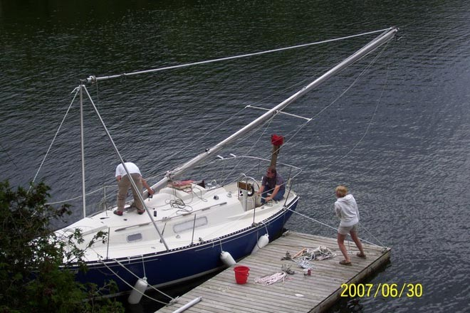 Checking the rigging - Taking the mast out of some boats is easier than others ©  SW
