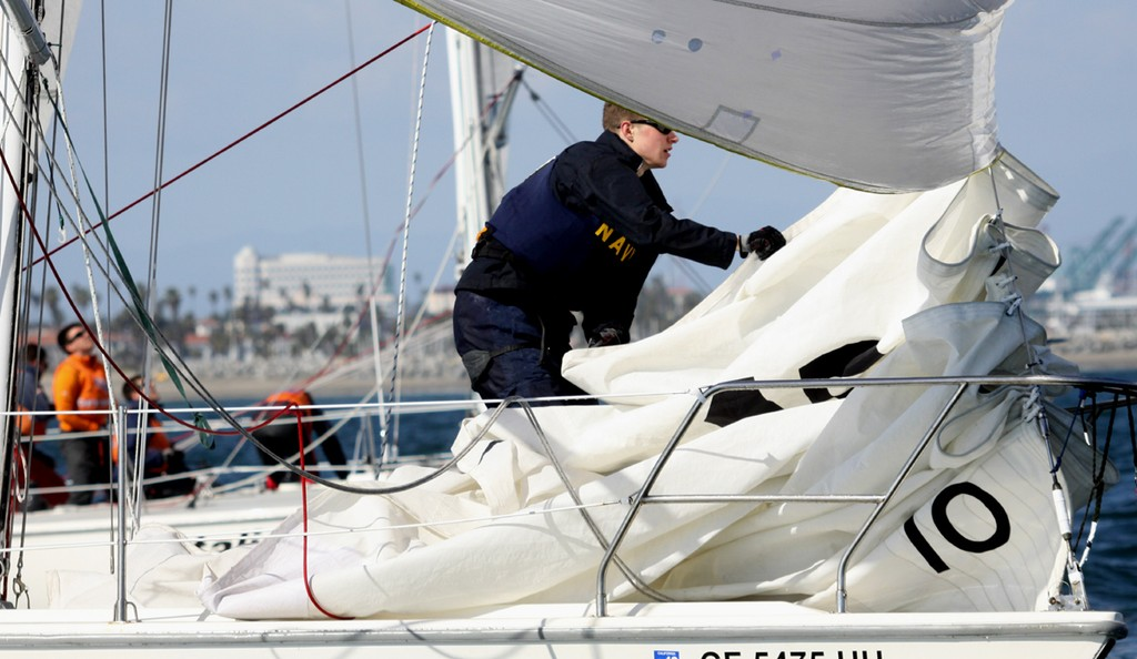 2013 Port of Los Angeles Harbor Cup - Navy douses its jib after raising the spinnaker to go downwind  © Rich Roberts / photo boat captain Mike Learned .