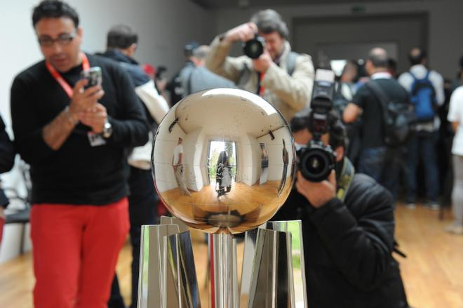 The ACWS trophy is the focus and everyone is keeping their eye on the ball to get it, even the photographers   - America's Cup WS, Naples Media Conference April 16, 2013. ©  SW