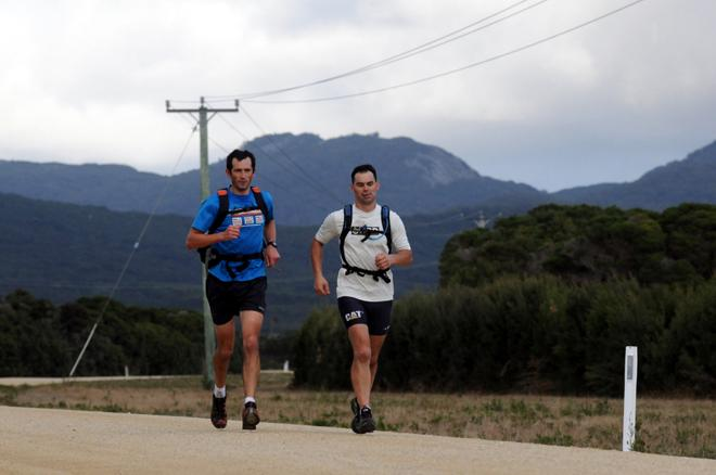 Whistler World runners Ian Franzke and Andrew McKenzie on the coast road back from Mount Strzelecki to Lady Barron - 2013 Three Peaks Race © Paul Scrambler