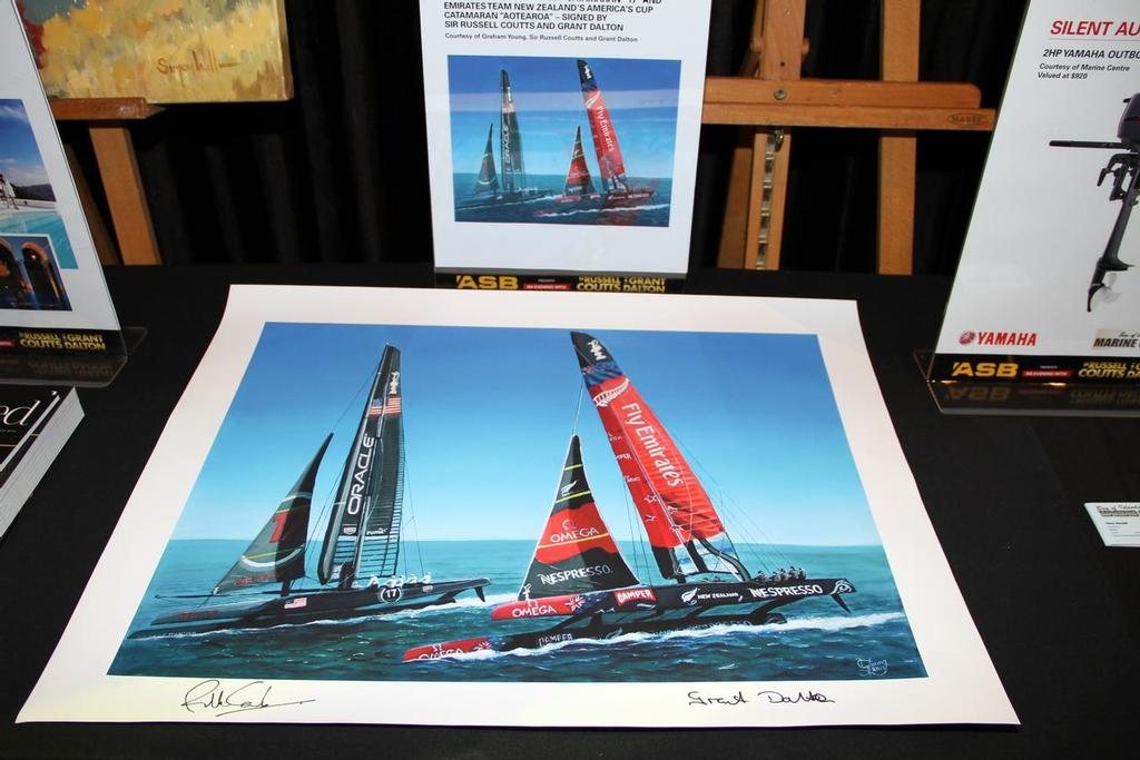 Several signed prints of Oracle Team USA and Emirates Team NZ's AC's was bid in a stand up auction © Richard Gladwell www.photosport.co.nz