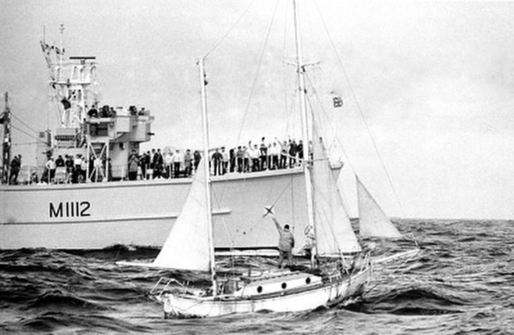 Circa 22nd April 1969: Robin Knox-Johnston waving aboard his 32ft yacht SUHAILI off Falmouth, England after becoming the first man to sail solo non-stop around the globe. Knox-Johnston was the sole finisher in the Sunday Times Golden Globe solo round the world race, having set out from Falmouth, England Falmouth, England on 14th June 1968 © Bill Rowntree - PPL http://www.pplmedia.com
