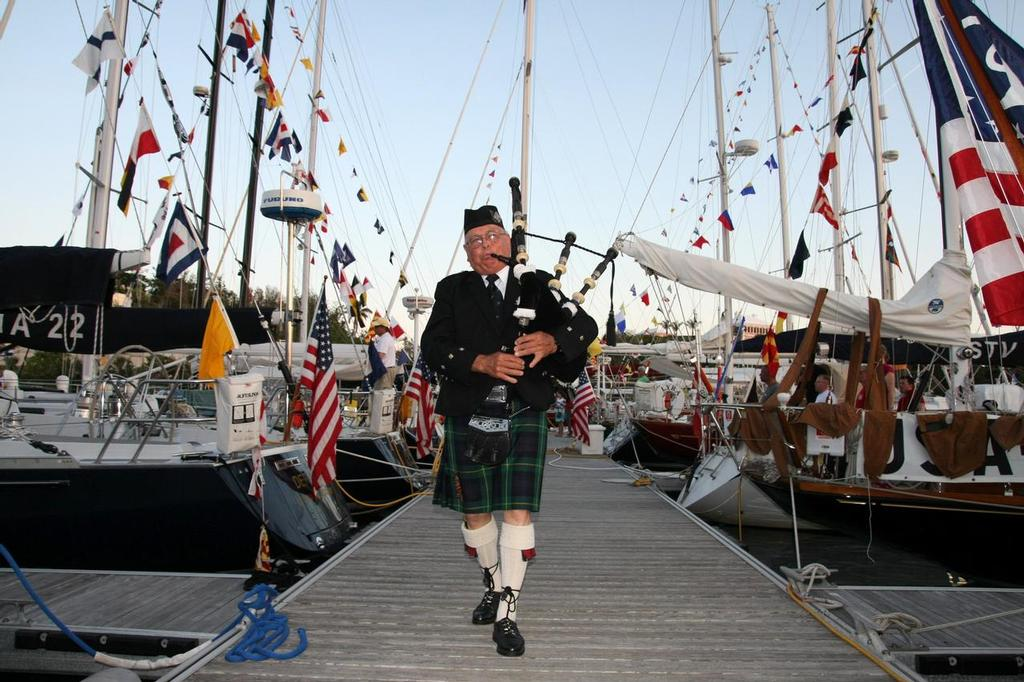 Are the Challengers being forced to march to the Defender's tune? David Frith Pipe Major of the Bermuda Islands Pipe Band plays the pipes and walks the docks as part of the traditional sunset ceremony at the Royal Hamilton Amateur Dinghy Club.  © Fran Grenon Spectrum Photos