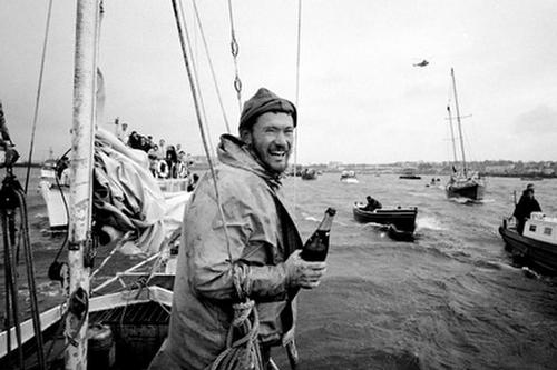 Circa 22nd April 1969: Robin Knox-Johnston celebrates aboard his 32ft yacht SUHAILI off Falmouth, England after becoming the first man to sail solo non-stop around the globe. Knox-Johnston was the sole finisher in the Sunday Times Golden Globe solo round the world race, having set out from Falmouth, England on 14th June 1968 © Bill Rowntree - PPL http://www.pplmedia.com