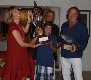 Victory for Mariella. Susanna and Enzo Addari, owners of The Inn at English Harbour present young Rocco Falcone with The Inn Challenge Trophy and Carlo Falcone holds the exquisite Lalique Victoire figurehead keepsake for winning the first edition of the regatta in Antigua - The inn challenge trophy photo copyright J Rainey taken at  and featuring the  class
