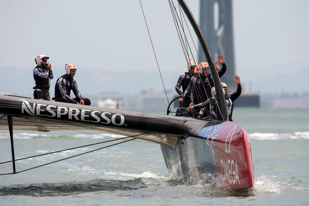 Emirates Team New Zealand wave to spectators after finishing their round robin 2 match of the Louis Vuitton Cup against Artemis Racing who were not sailing. 14/7/2013 © Chris Cameron/ETNZ http://www.chriscameron.co.nz