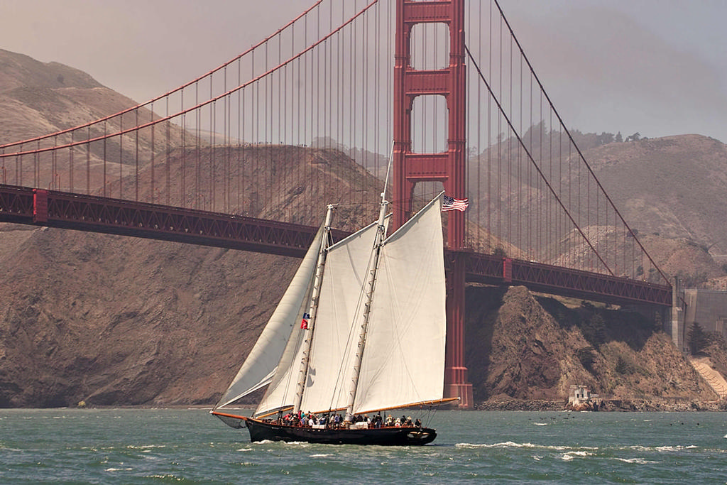 The replica of the yacht America under sail at the Golden Gate bridge on race day.  - America's Cup 2013 © Chuck Lantz http://www.ChuckLantz.com