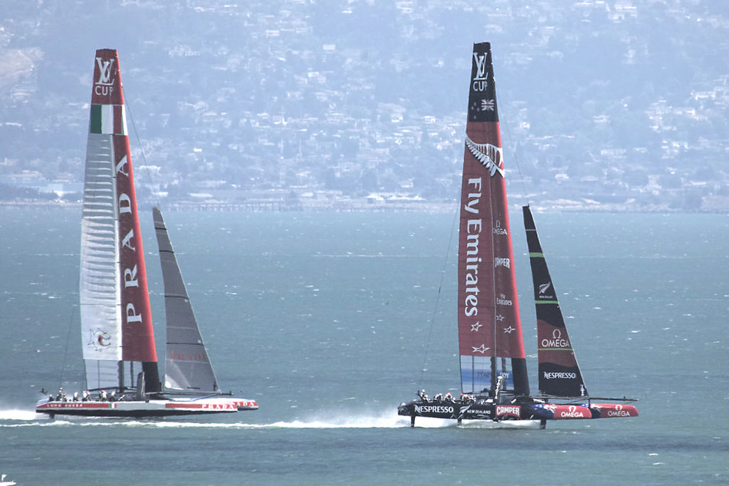 ETNZ flies downwind on her foils, with Prada trailing during practice session - America's Cup © Chuck Lantz http://www.ChuckLantz.com