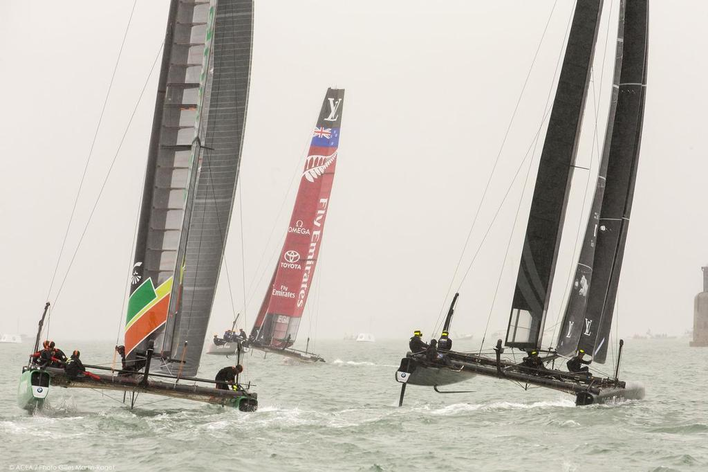 Emirate Team NZ leads in the murk of the English summer Practice Day 35th America's Cup, Louis Vuitton America's Cup World Series Portsmouth 2015 © ACEA /Gilles Martin-Raget