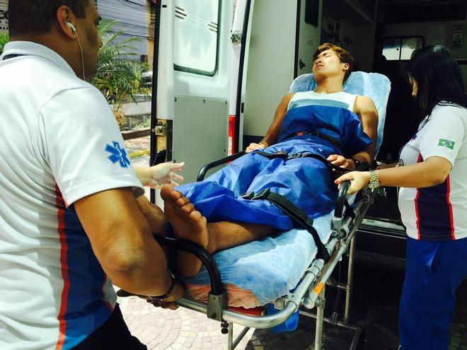 RS:X Windsurfer, Wonwoo Cho (KOR) being loaded into an ambulance prior to being hospitalised © SW