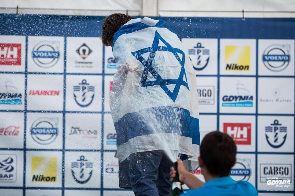Yoav Omer is sprayed with champagne -  RS:X Class Youth World Championships, Gdynia, Poland © RS:X class.com http://www.rsxclass.com