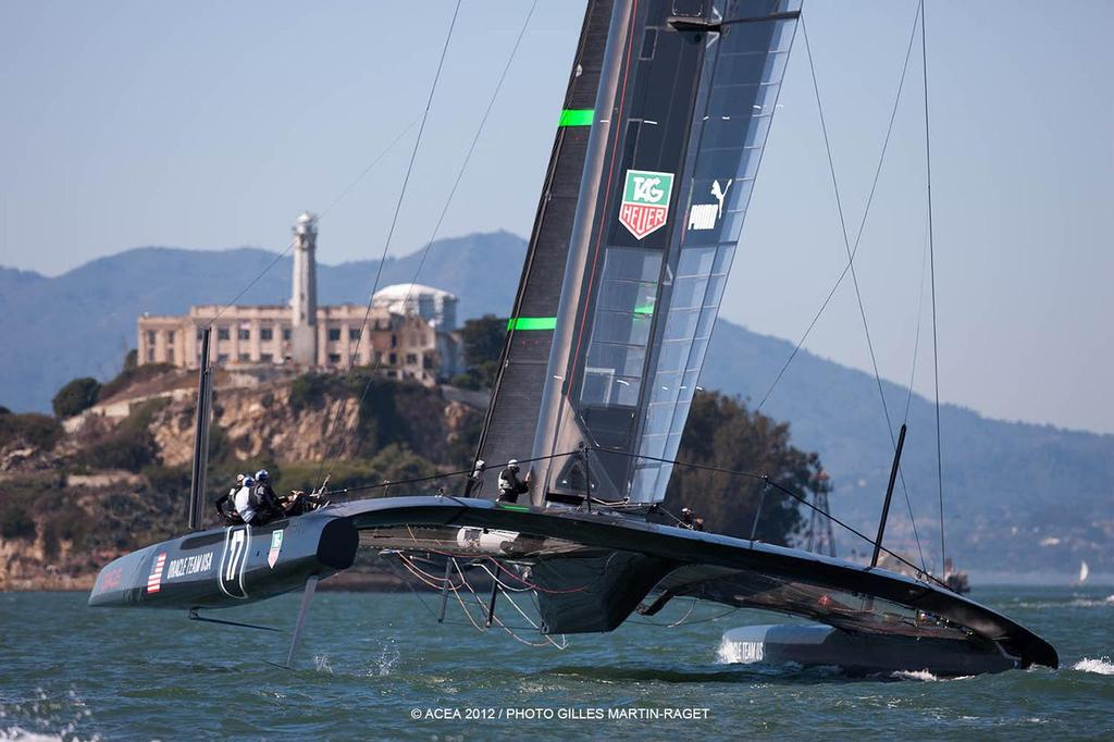 It is claimed that Oracle Team USA crew members pumped the wingsail sheet to lift the AC72 quickly onto her foils  © ACEA - Photo Gilles Martin-Raget http://photo.americascup.com/